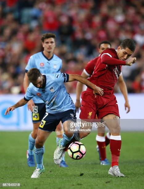 Roberto Firmino of Liverpool and Michael Zullo of Sydney FC compete for the ball during the International Friendly match between Sydney FC and...