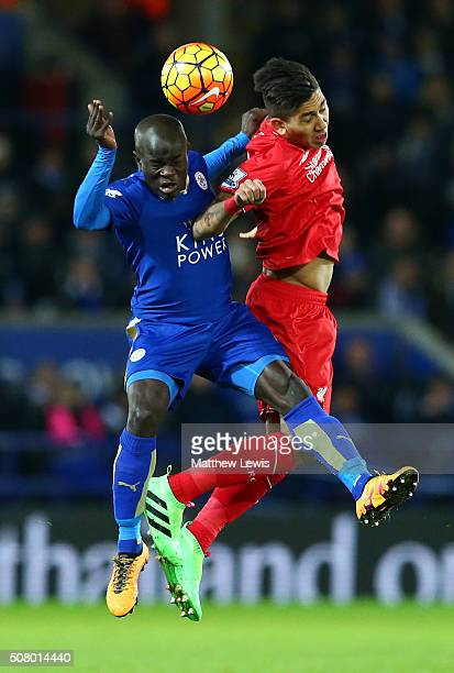 Roberto Firmino of Liverpool and Ngolo Kante of Leicester City compete for the ball during the Barclays Premier League match between Leicester City...