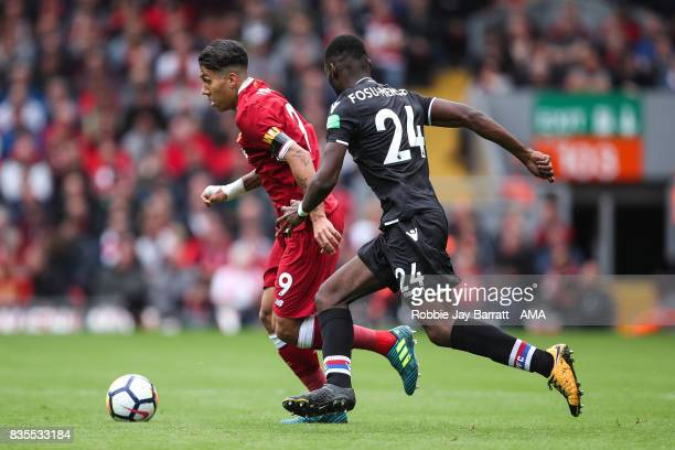 Roberto Firmino of Liverpool and Timothy FosuMensah of Crystal Palace during the Premier League match between Liverpool and Crystal Palace at Anfield...