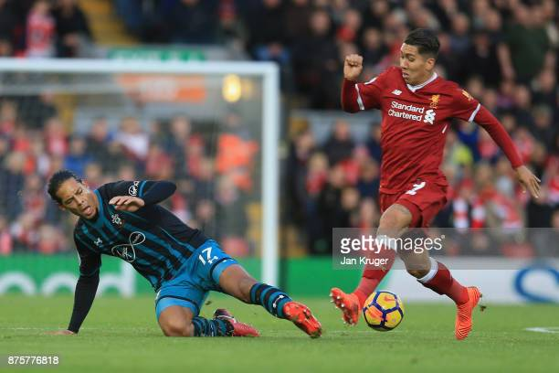 Roberto Firmino of Liverpool and Virgil van Dijk of Southampton compete for the ball during the Premier League match between Liverpool and...