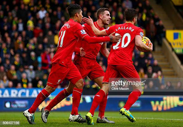 Roberto Firmino of Liverpool ceelbrates scoring his team's third goal with his team mates Jordan Henderson and Adam Lallana during the Barclays...