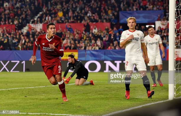 Roberto Firmino of Liverpool celebrates after scoring the third goal during the UEFA Champions League group E match between Sevilla FC and Liverpool...