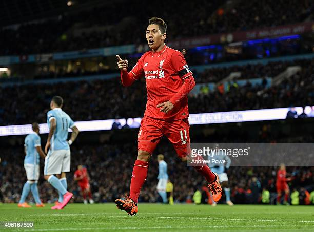 Roberto Firmino of Liverpool celebrates after scoring the third during the Barclays Premier League match between Manchester City and Liverpool at...