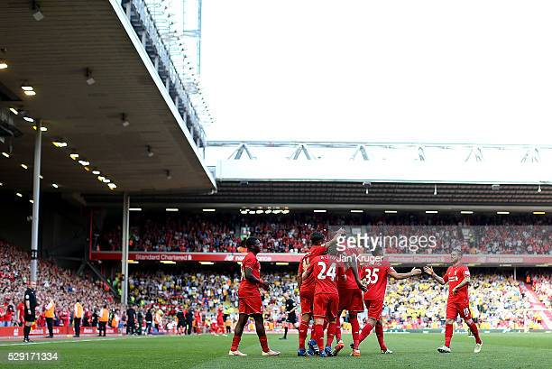 Roberto Firmino of Liverpool celebrates his goal with team mates during the Barclays Premier League match between Liverpool and Watford at Anfield on...
