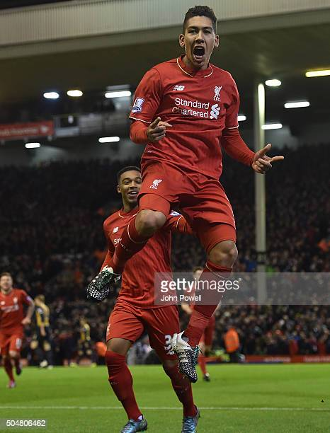Roberto Firmino of Liverpool celebrates his second goal during the Barclays Premier League match between Liverpool and Arsenal at Anfield on January...