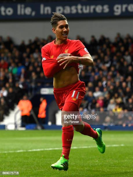 Roberto Firmino of Liverpool celebrates scoring his sides first goal during the Premier League match between West Bromwich Albion and Liverpool at...