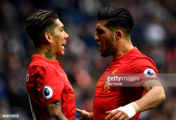 Roberto Firmino of Liverpool celebrates scoring his sides first goal with Emre Can of Liverpool during the Premier League match between West Bromwich...