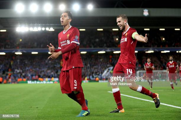 Roberto Firmino of Liverpool celebrates scoring his sides fourth goal with Jordan Henderson of Liverpool during the UEFA Champions League Qualifying...