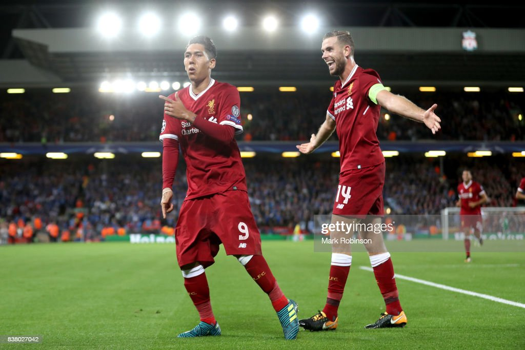 Roberto Firmino of Liverpool celebrates scoring his sides fourth goal with Jordan Henderson of Liverpool during the UEFA Champions League Qualifying Play-Offs round second leg match between Liverpool FC and 1899 Hoffenheim at Anfield on August 23, 2017 in Liverpool, United Kingdom.
