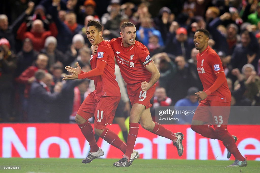 Roberto Firmino of Liverpool celebrates scoring his team's second goal with his team mate Jordan Henderson and Jordon Ibe during the Barclays Premier...