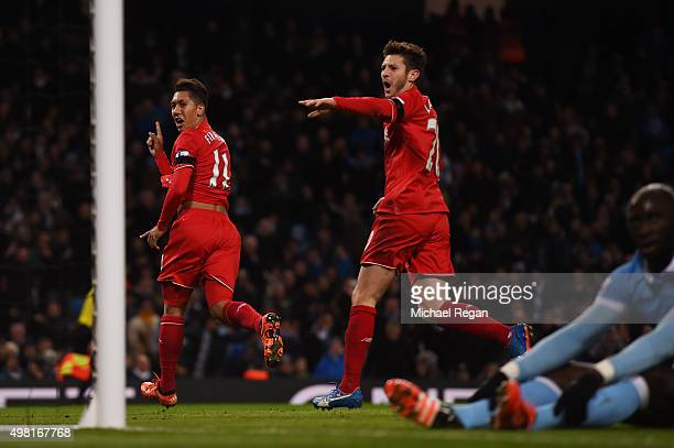 Roberto Firmino of Liverpool celebrates scoring his team's third goal with his team mate Adam Lallana during the Barclays Premier League match...