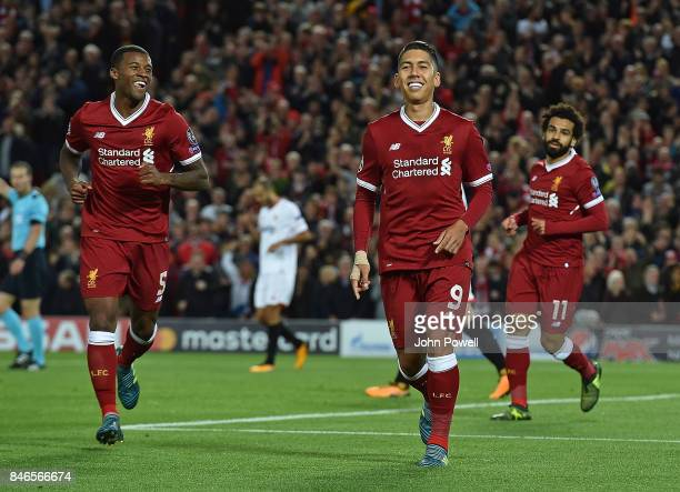 Roberto Firmino of Liverpool celebrates the opening goal for Liverpool during the UEFA Champions League group E match between Liverpool FC and...