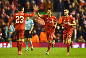 Roberto Firmino of Liverpool celebrates with Emre Can as he scores their second goal during the UEFA Europa League Round of 16 first leg match...