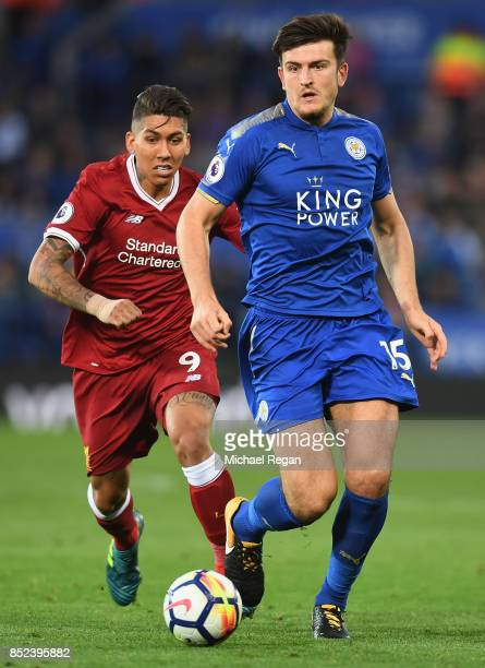 Roberto Firmino of Liverpool chases down Harry Maguire of Leicester City during the Premier League match between Leicester City and Liverpool at The...