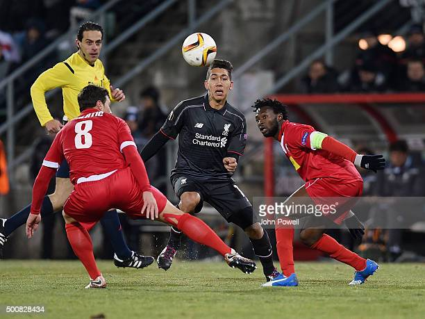 Roberto Firmino of Liverpool competes with Carlitos of FC Sion during the UEFA Europa League match between FC Sion and Liverpool FC at Estadio...