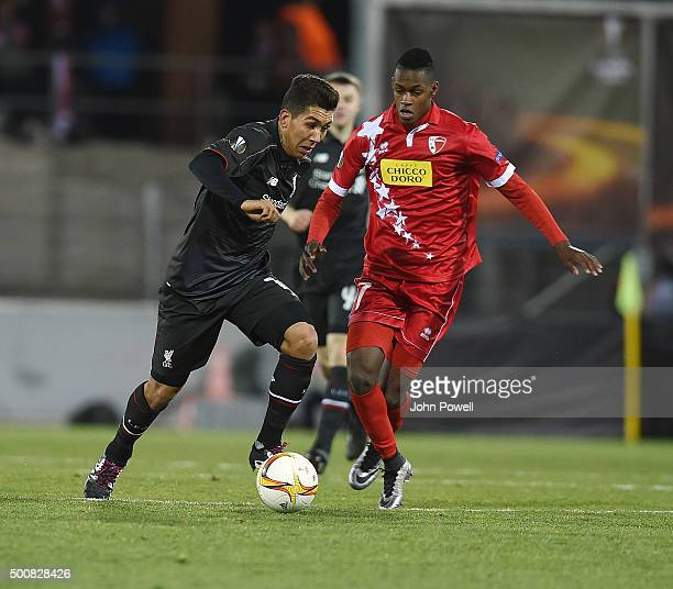 Roberto Firmino of Liverpool competes with Edimilson Fernandes of FC Sion during the UEFA Europa League match between FC Sion and Liverpool FC at...