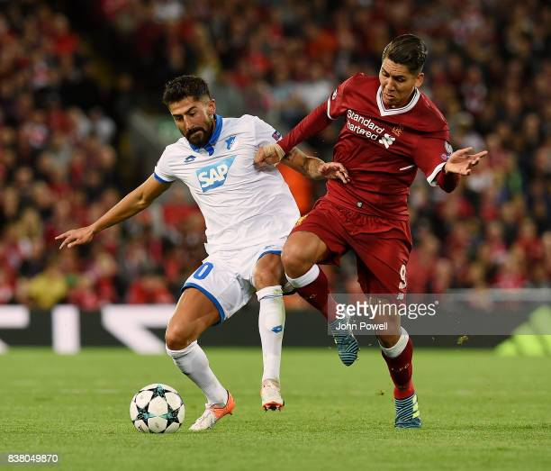 Roberto Firmino of Liverpool competes with Kerem Demirbay of 1899 Hoffenheim during the UEFA Champions League Qualifying PlayOffs round second leg...