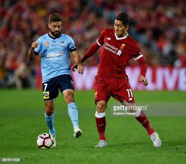 Roberto Firmino of Liverpool competes with Michael Zullo of Sydney FC during the International Friendly match between Sydney FC and Liverpool FC at...