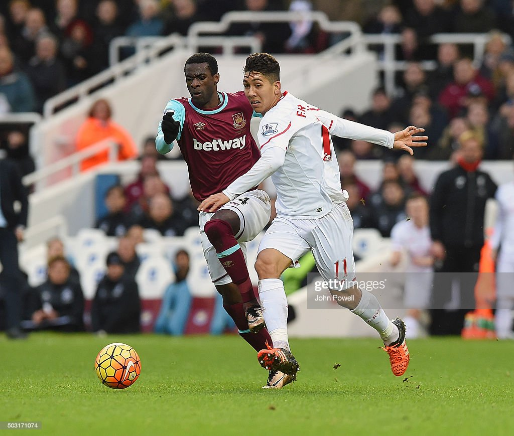 Roberto Firmino of Liverpool competes with Pedro Mba Obiang of West Ham United during the Barclays Premier League match between West Ham United and Liverpool at Boleyn Ground on January 2, 2016 in London, England.