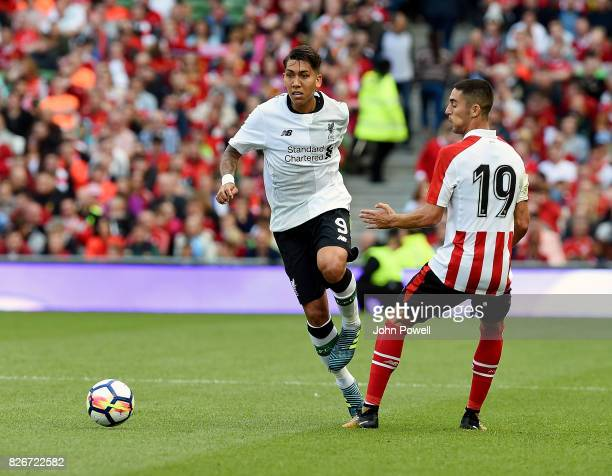 Roberto Firmino of Liverpool competes with Sabin Merino of Athletic Bilbao during a pre season friendly match between Liverpool and Athletic Bilbao...
