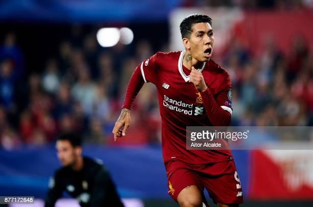 Roberto Firmino of Liverpool FC celebrates after scoring his team's third goal during the UEFA Champions League group E match between Sevilla FC and...