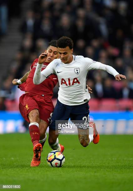 Roberto Firmino of Liverpool fouls Dele Alli of Tottenham Hotspur during the Premier League match between Tottenham Hotspur and Liverpool at Wembley...