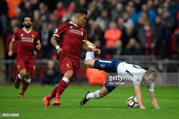Roberto Firmino of Liverpool fouls Harry Kane of Tottenham Hotspur during the Premier League match between Tottenham Hotspur and Liverpool at Wembley...