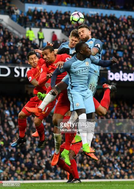 Roberto Firmino of Liverpool Georginio Wijnaldum of Liverpool John Stones of Manchester City Nicolas Otamendi of Manchester City and Bacary Sagna of...
