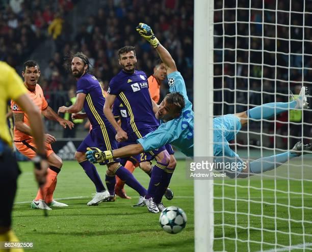 Roberto Firmino of Liverpool heads the ball past Jasmin Handanovic of NK Maribor during the UEFA Champions League group E match between NK Maribor...