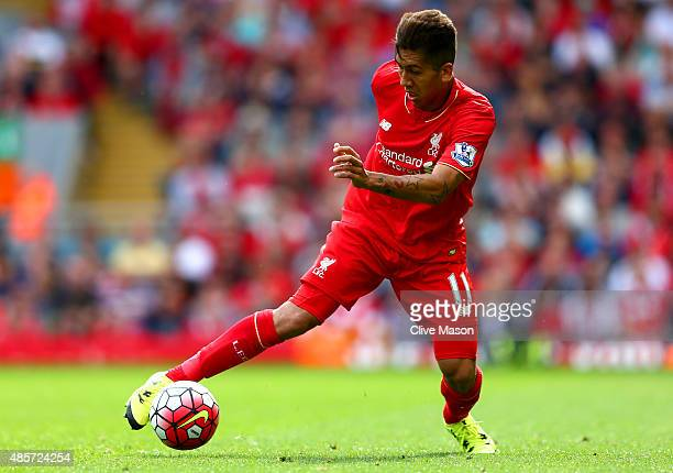 Roberto Firmino of Liverpool in action during the Barclays Premier League match between Liverpool and West Ham United at Anfield on August 29 2015 in...