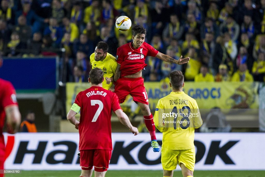 Roberto Firmino (R-2) of Liverpool in action during the UEFA Europa League Semi Final match between Villarreal and Liverpool at Estadio El Madrigal in Villareal, Spain on April 28, 2016.