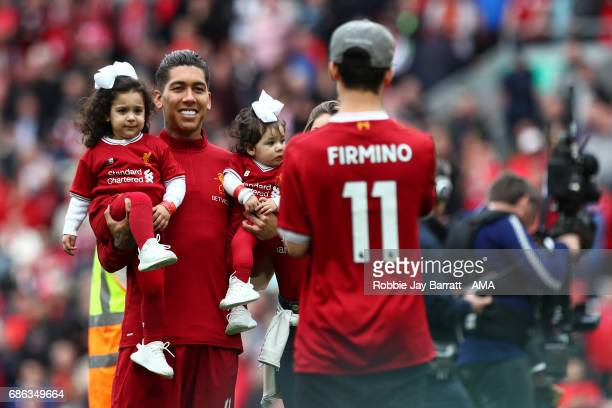 Roberto Firmino of Liverpool on the pitch with his family during the Premier League match between Liverpool and Middlesbrough at Anfield on May 21...