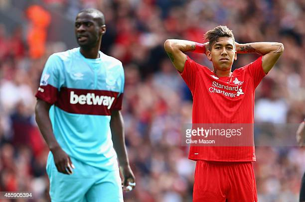 Roberto Firmino of Liverpool rues a missed opportunity during the Barclays Premier League match between Liverpool and West Ham United at Anfield on...