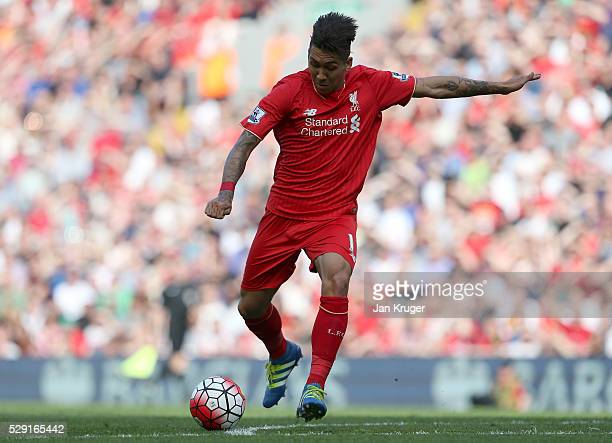 Roberto Firmino of Liverpool scores his side's second goal during the Barclays Premier League match between Liverpool and Watford at Anfield on May 8...