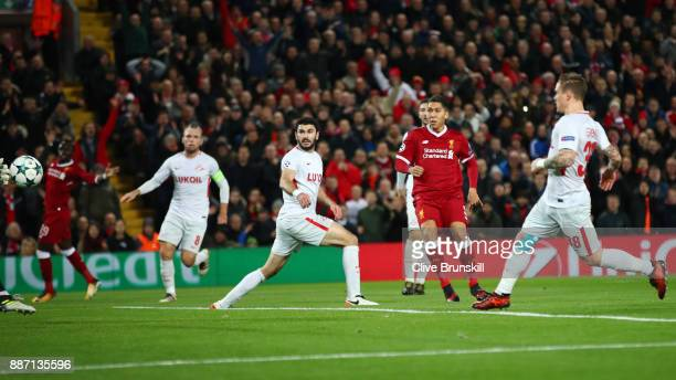 Roberto Firmino of Liverpool scores his sides third goal during the UEFA Champions League group E match between Liverpool FC and Spartak Moskva at...