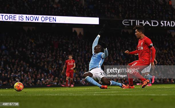 Roberto Firmino of Liverpool scores his team's third goal during the Barclays Premier League match between Manchester City and Liverpool at Etihad...