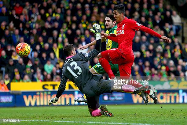 Roberto Firmino of Liverpool scores his team's third goal during the Barclays Premier League match between Norwich City and Liverpool at Carrow Road...