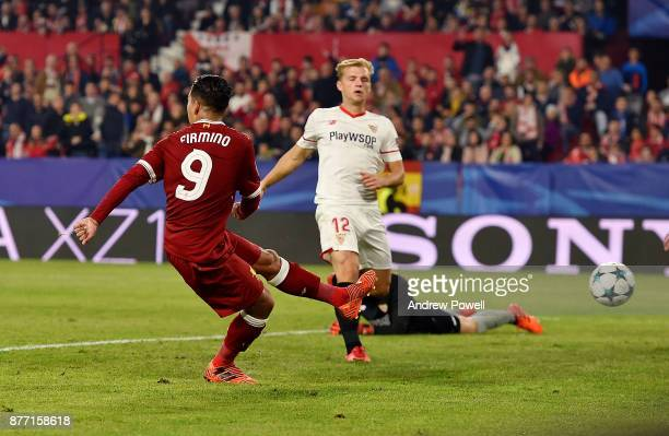 Roberto Firmino of Liverpool scores the third goal during the UEFA Champions League group E match between Sevilla FC and Liverpool FC at Estadio...