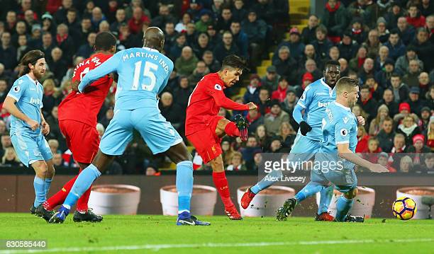 Roberto Firmino of Liverpool scores their second goal during the Premier League match between Liverpool and Stoke City at Anfield on December 27 2016...
