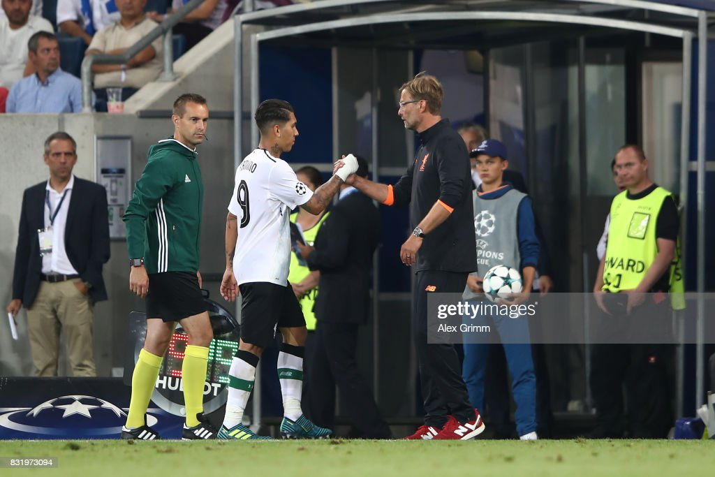 Roberto Firmino of Liverpool (l) shakes hands with Juergen Klopp as he is substituted during the UEFA Champions League Qualifying Play-Offs Round First Leg match between 1899 Hoffenheim and Liverpool FC at Wirsol Rhein-Neckar-Arena on August 15, 2017 in Sinsheim, Germany.
