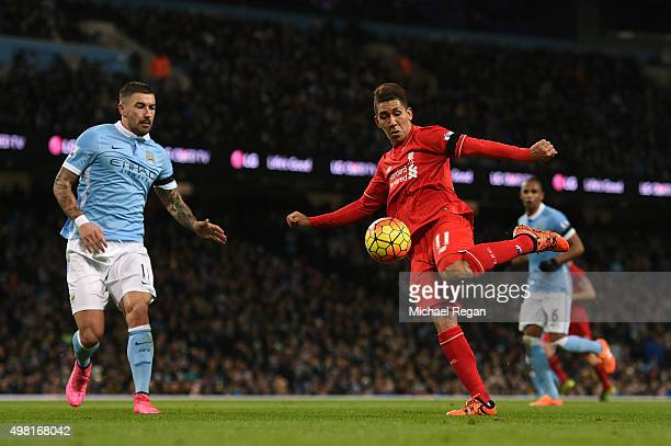 Roberto Firmino of Liverpool shoots at goal during the Barclays Premier League match between Manchester City and Liverpool at Etihad Stadium on...