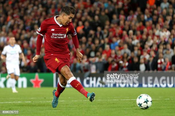 Roberto Firmino of Liverpool shoots during the UEFA Champions League Qualifying PlayOffs round second leg match between Liverpool FC and 1899...