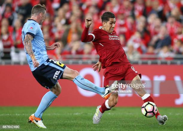 Roberto Firmino of Liverpool takes on Sebastian Ryall of Sydney FC during the International Friendly match between Sydney FC and Liverpool FC at ANZ...