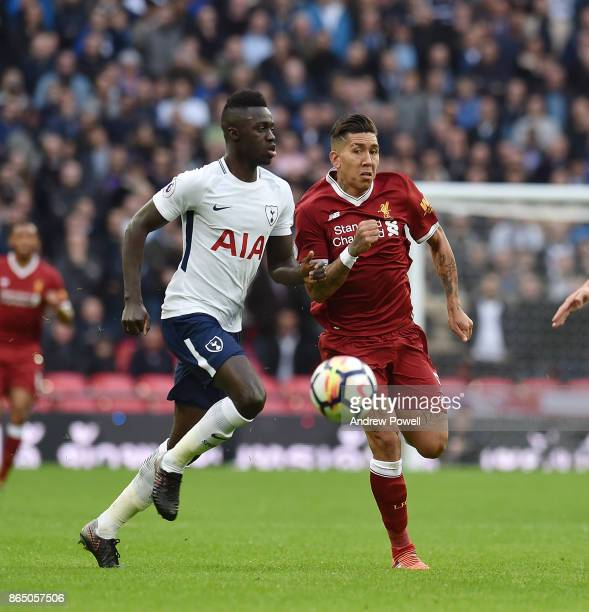 Roberto Firmino of Liverpool with Davinson Sanchez of Tottenham during the Premier League match between Tottenham Hotspur and Liverpool at Wembley...