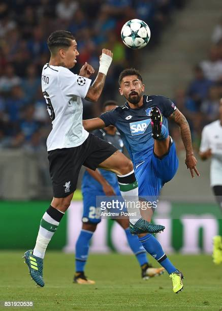 Roberto Firmino of Liverpool with Kerem Demirbay of TSG 1899 during the UEFA Champions League Qualifying PlayOffs Round First Leg match between 1899...