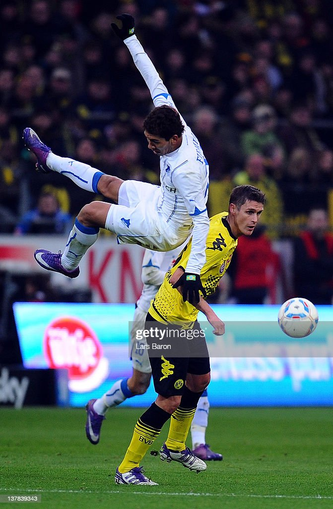 Roberto Firmono of Hoffenheim jumps over <a gi-track='captionPersonalityLinkClicked' href=/galleries/search?phrase=Sebastian+Kehl&family=editorial&specificpeople=486611 ng-click='$event.stopPropagation()'>Sebastian Kehl</a> of Dortmund during the Bundesliga match between Borussia Dortmund and 1899 Hoffenheim at Signal Iduna Park on January 28, 2012 in Dortmund, Germany.