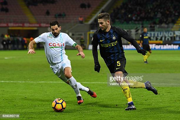 Roberto Gagliardin of FC Internazionale in action against Sergio Pellissier of AC ChievoVerona during the Serie A match between FC Internazionale and...