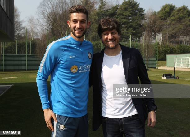 Roberto Gagliardini and actor Fabio De Luigi at FC Internazionale's training ground Suning Training Center in memory of Angelo Moratti on March 16...