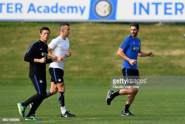 Roberto Gagliardini and Ivan Perisic of FC Internazionale in action during the training session at Suning Training Center at Appiano Gentile on...