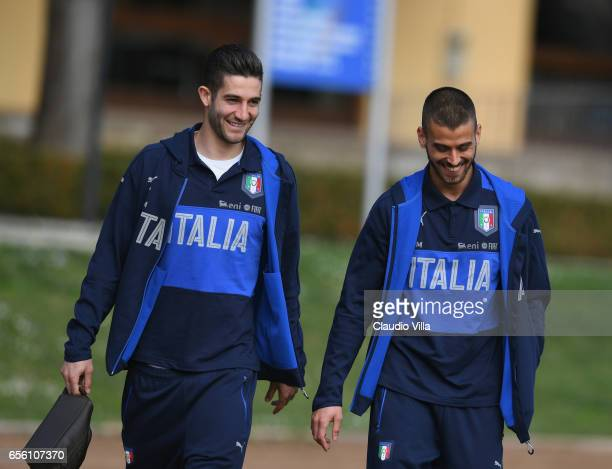 Roberto Gagliardini and Leonardo Spinazzola of Italy chat prior to the training session at the club's training ground at Coverciano on March 21 2017...